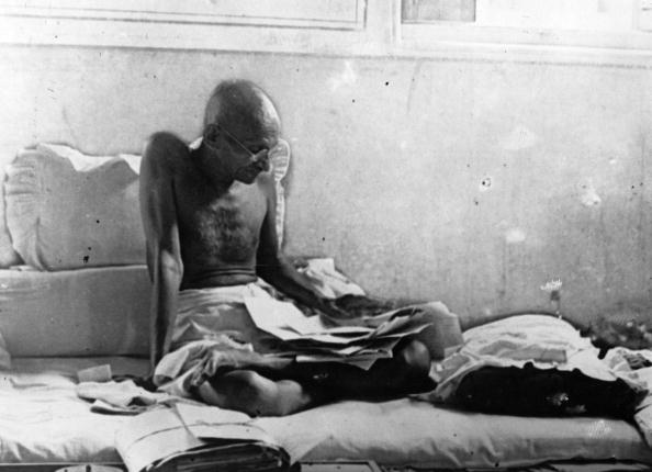 Indian statesman Mahatma Gandhi (Mohandas Karamchand Gandhi, 1969 - 1948) fasts in protest against British rule after his release from prison in Poona, India. (Photo by Keystone/Getty Images).