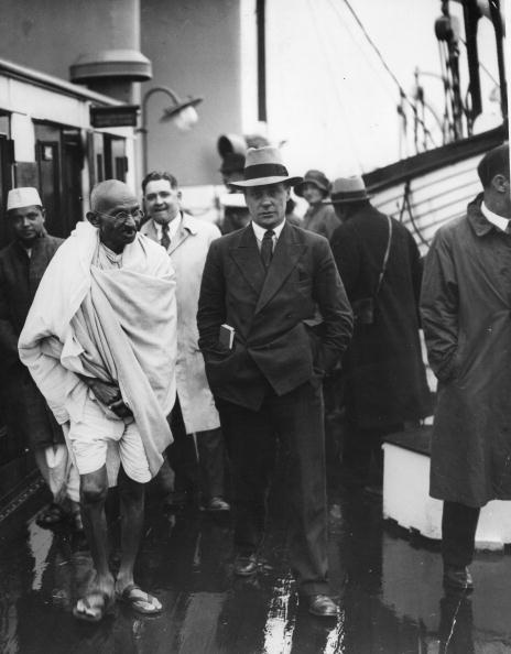 12th September 1931: Indian nationalist leader and thinker Mahatma Gandhi (Mohandas Karamchand Gandhi) on the deck of a boat taking him from Boulogne, France, to Folkestone in England for a Round Table Conference. (Photo by Douglas Miller/Topical Press Agency/Getty Images)