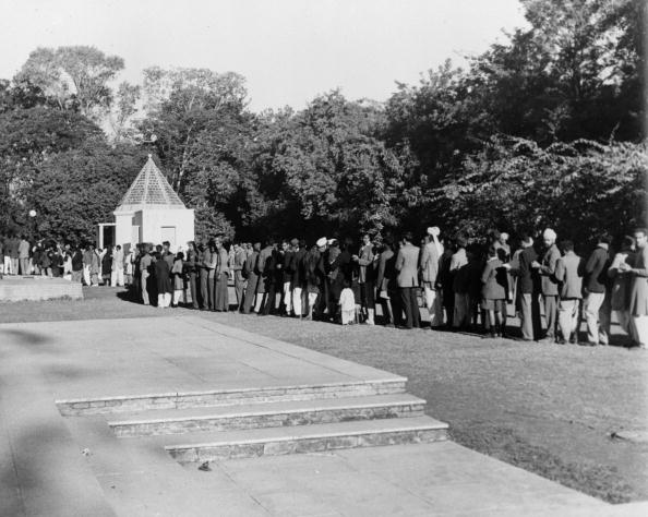 Crowds queuing to pay tribute to the Indian statesman and advocate of non-violence, Mahatma Gandhi (Mohandas Karamchand Gandhi), at the Birla House in Delhi where he was assassinated. (Photo by Fox Photos/Getty Images)