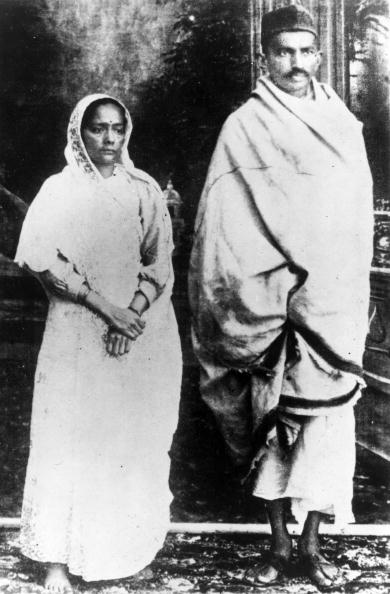 January 1922: Indian nationalist leader and organizer of the Indian National Congress's campaign of passive non-cooperation, Mahatma Gandhi (Mohandas Karamchand Gandhi, 1869 - 1948) with his wife, shortly before his arrest for conspiracy. (Photo by Topical Press Agency/Getty Images)