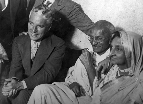Indian political and spiritual leader Mahatma Gandhi (Mohandas Karamchand Gandhi), centre, and his wife meet film actor Charlie Chaplin at the home of Dr Katral in Canning Town, east London. Original Publication: People Disc - HD0266 (Photo by London Express/Getty Images)