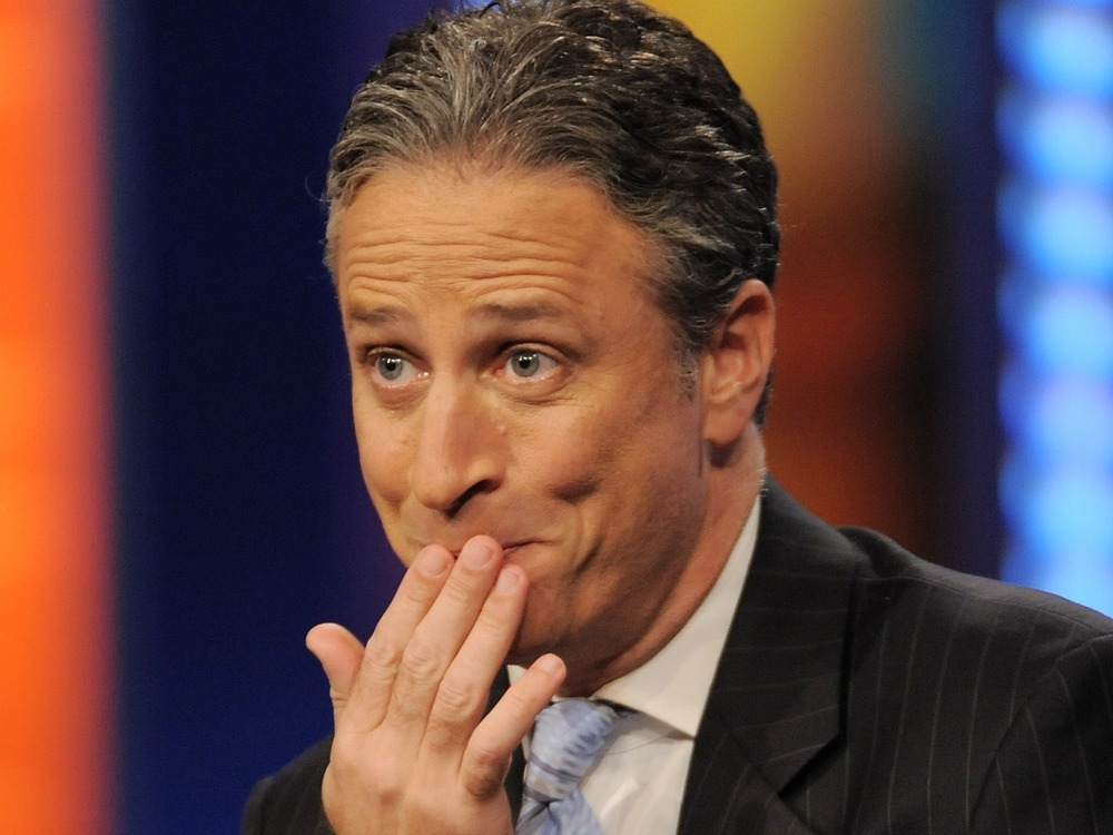 """** FILE ** In this Oct. 8, 2008 file photo, host Jon Stewart gestures during a taping of """"The Daily Show with Jon Stewart"""" in New York. (AP Photo/Evan Agostini, file)"""